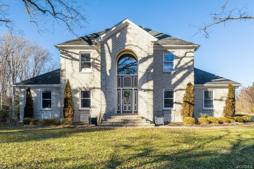 You are going to LOVE this 4 bed, 3.5 bath brick estate style home located on over 3 acres in Sandst