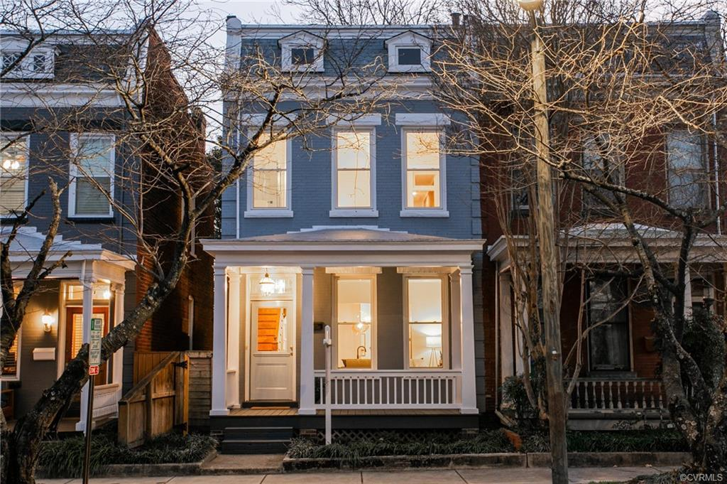 Located in the heart of the Fan, this brilliant 1910 rowhouse has been completely renovated. Sleek n