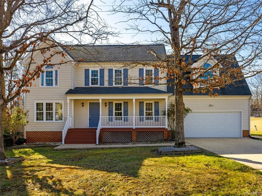 You'll fall in love when you walk in the front door! This 4 bedroom, 2.5 bath beauty has lots of new