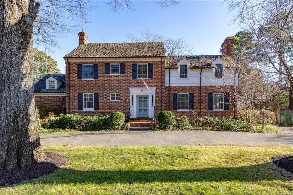 Welcome to 409 Harlan Circle in popular Hampton Gardens.  This lovely brick & slate 2 story colonial