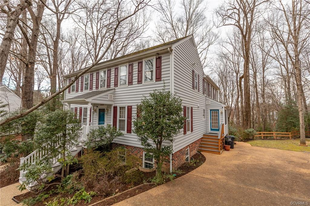 Enjoy the park-like setting and scenic creek-side views from the expansive deck on this charming and