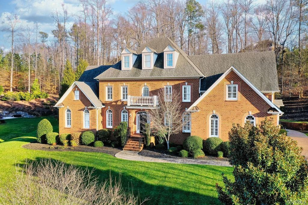 Looking for a custom brick home with all the bells & whistles? Feast your eyes on this 6 bed, 5 and