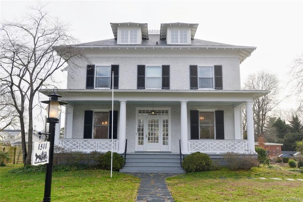 Don't miss a rare opportunity to own this pristine Colonial Revival in the sought-after Laburnum Park neighborhood. With its wide, classical columned porch and hipped roof with deep, carved brackets, the home exudes welcoming comfort. Occupied and beautifully maintained by the same family since 1961, it offers 3,200 square feet of finished space, along with a partially finished, multi-room attic. The first floor has two parlors and a formal dining room, along with a large kitchen with granite countertops and a dining area. The upstairs offers five bedrooms, as well as a strikingly large hallway with ample storage. Two of the bedrooms have a connecting door – perfect for a nursery and a nanny. Heart-pine floors on both levels, as well as the attic stairs. 2½ baths. Two fireplaces. Basement with a gas furnace and a washer and dryer. The house sits on a flat ½-acre lot, and the backyard has a large deck and a brick outbuilding with a metal roof. Just move in and enjoy the historic North Side lifestyle!