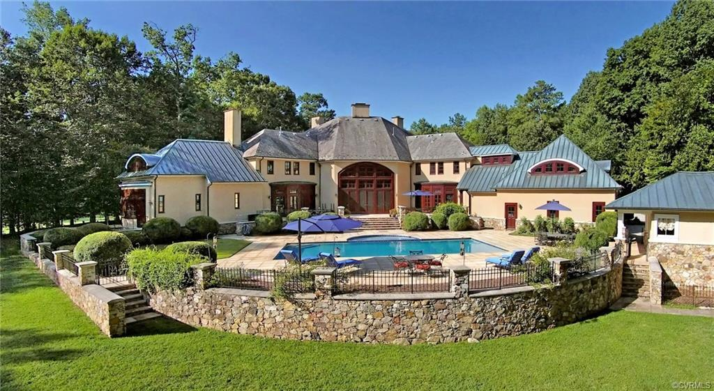 French Country estate designed by Mark Spangler overlooks the 2nd hole of Sabot course at Hermitage