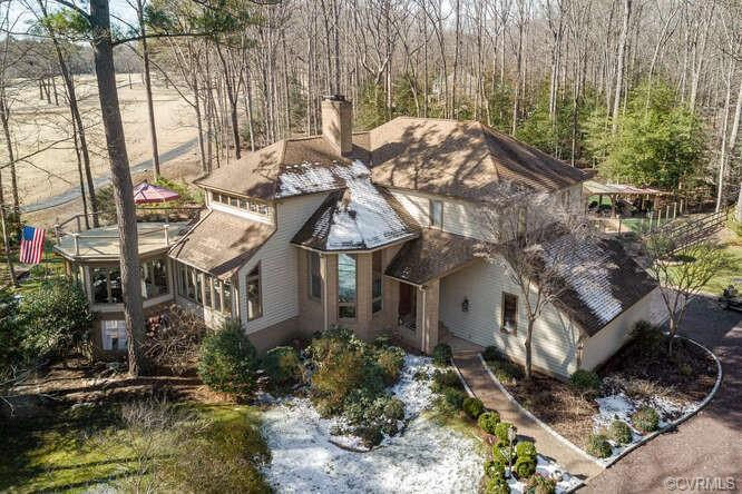 Come home daily to your own peaceful sanctuary! Privately situated on 2+ wooded acres with golf cour