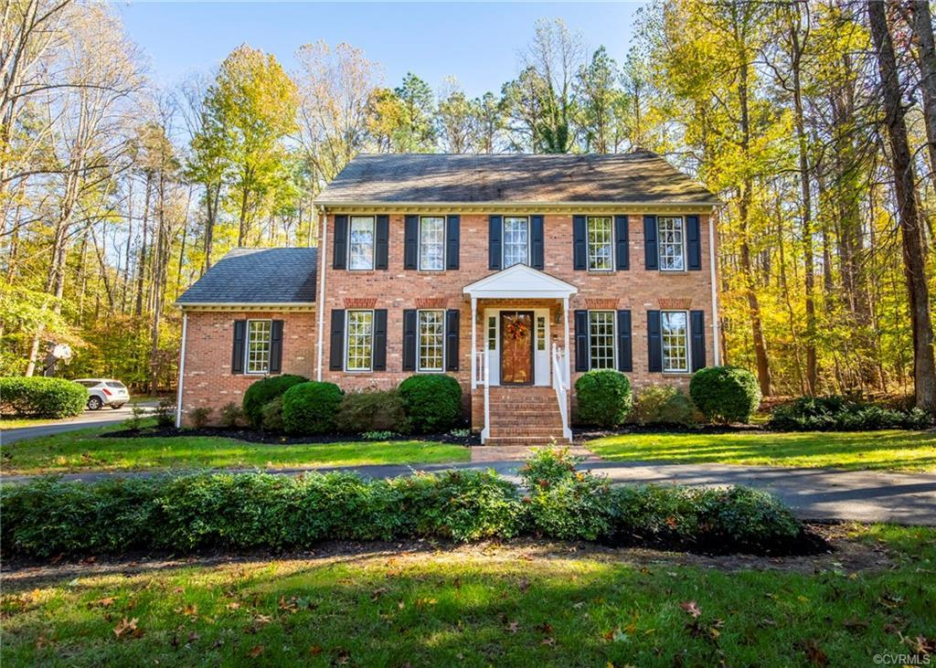 Welcome Home to this ALL brick custom built builder's home sitting on almost an acre. This beautiful
