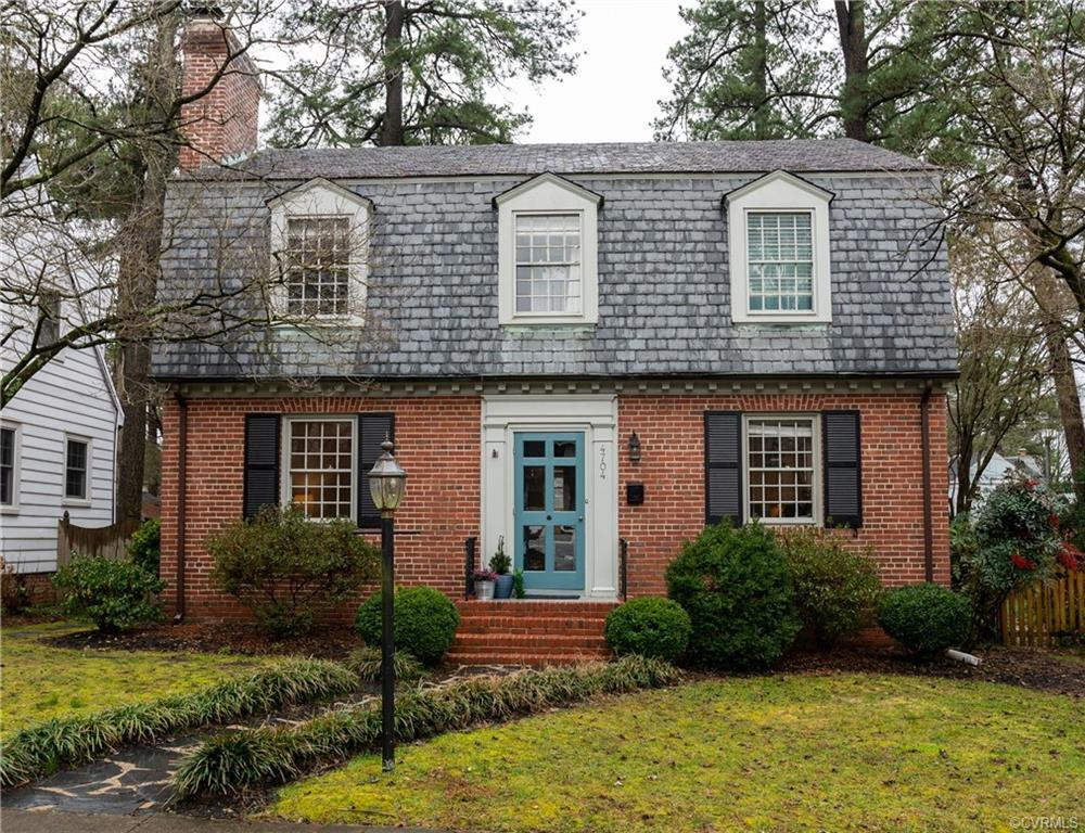 This beautiful brick and slate Dutch colonial just south of the river is an idyllic Westover Hills h