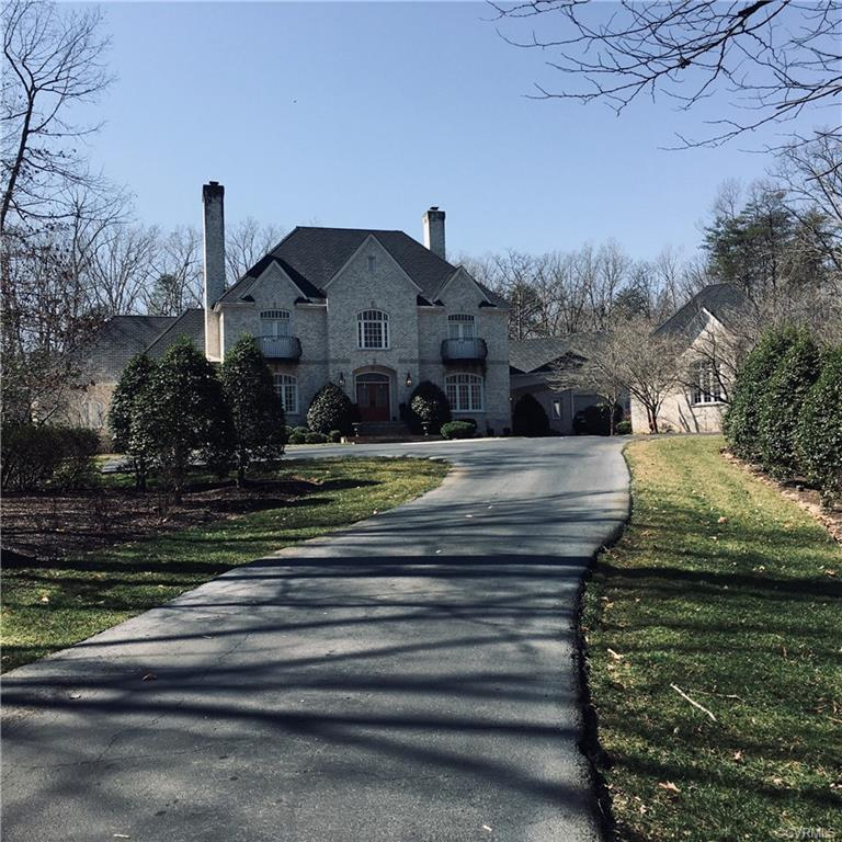 This Stinson Builders french 2003 grey stone custom designed home in the gated golf course community