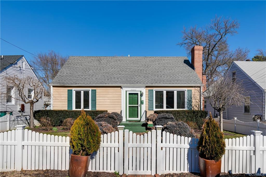 This charming cape cod with white picket fence is move-in ready and boasts tons of upgrades. The fir