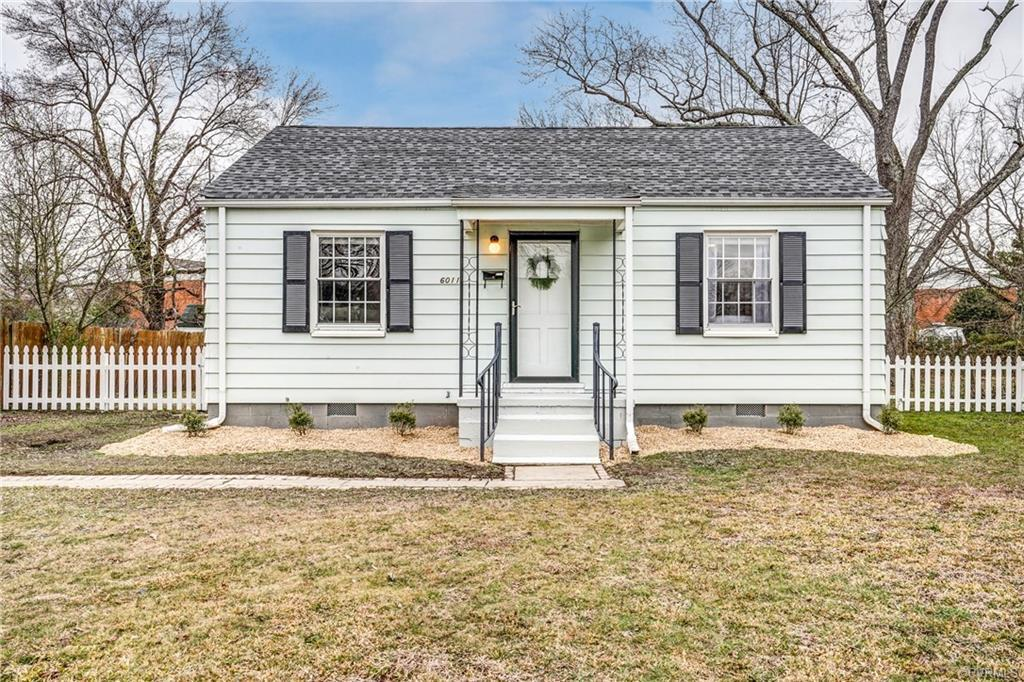 This cozy bungalow is a great place to call home. The front door opens into a living room, bright wi
