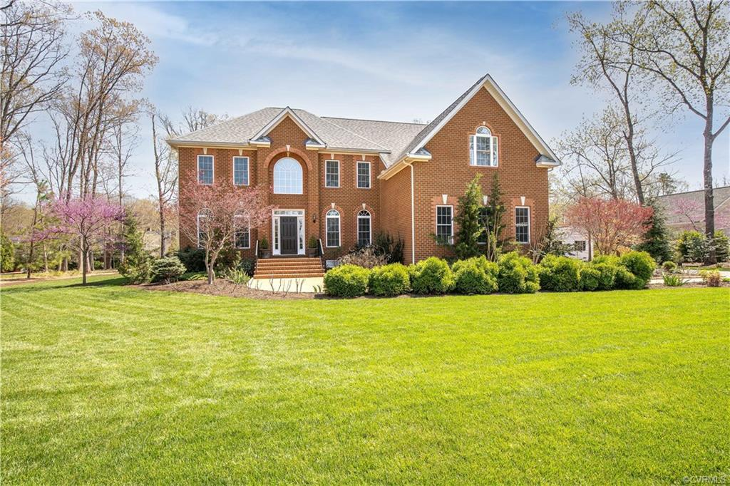 Spectacular, brick Executive Home situated on a magnificent, private lot which features manicured gr
