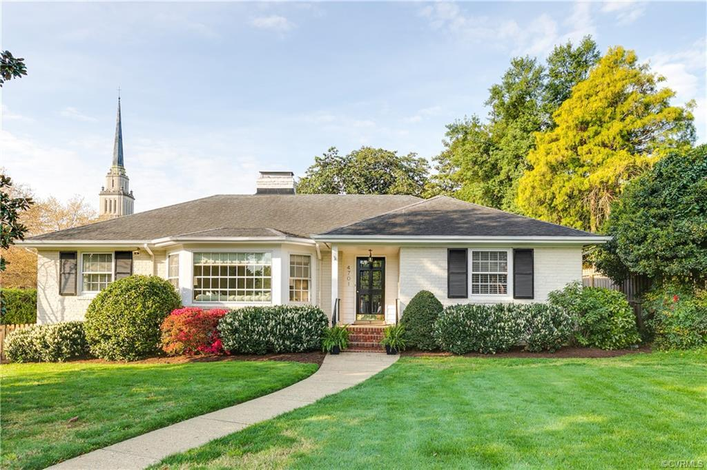 Charming brick ranch situated on a large corner lot in a prime location! Unique wide foyer opens to