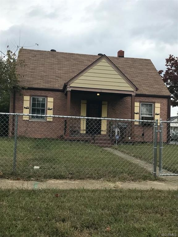 """Desirable fenced corner lot. Fence 1 year old. House is sold """"AS IS""""."""