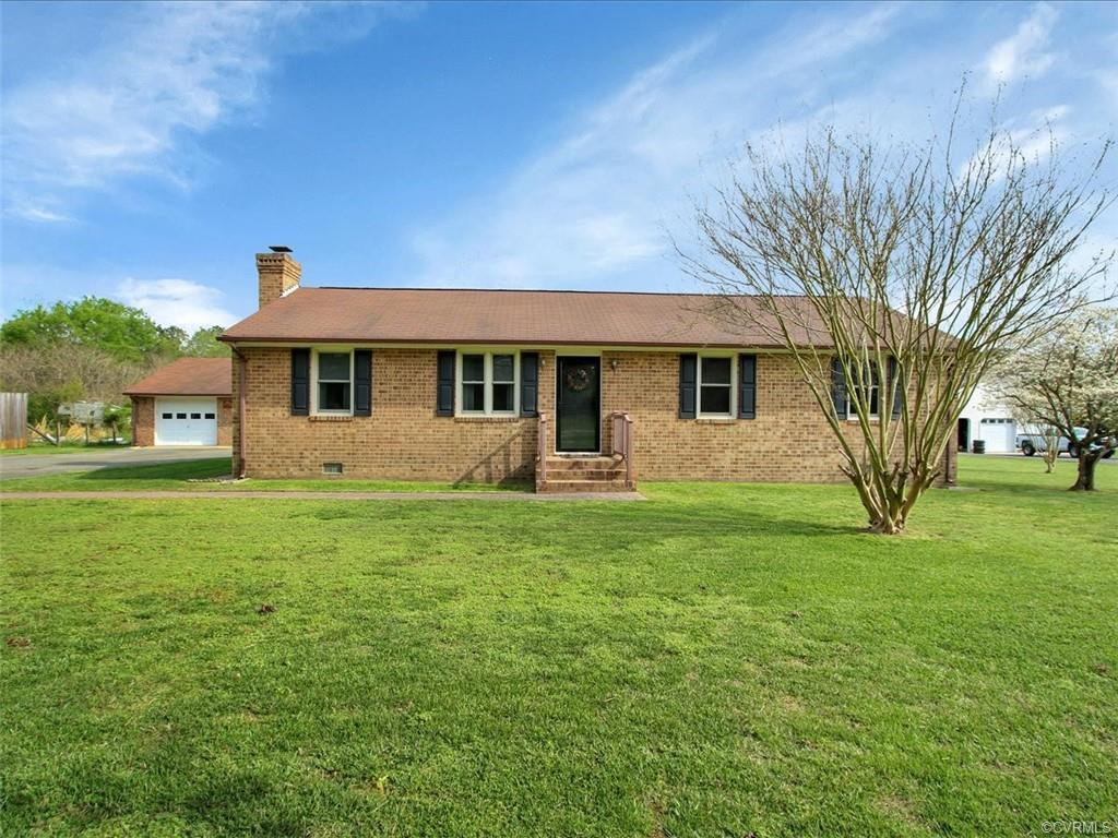Well maintained 3 bedroom,2 bath brick rancher w/rear enclosed porch,paved drive leading to detached