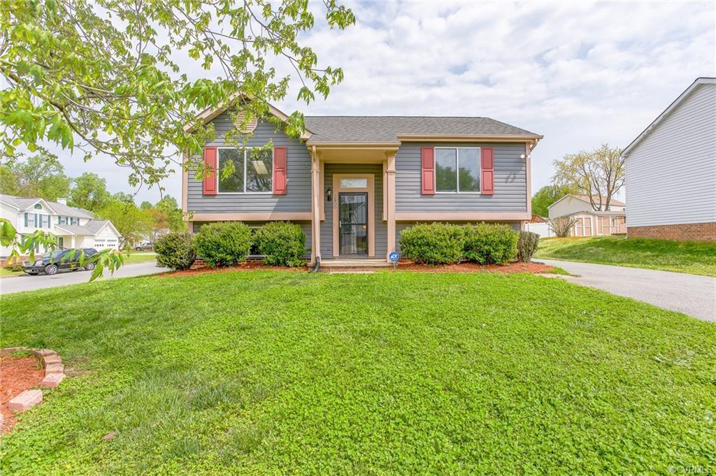 This beautiful split foyer home gives you the option to relax in the family room or head upstairs. T