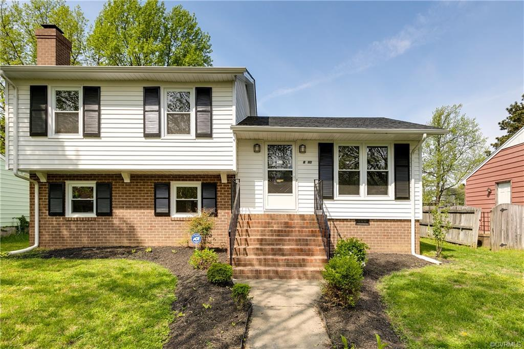 Welcome home to this renovated gem in Washington Park. This adorable 4 bedroom, 2 full bath boasts o