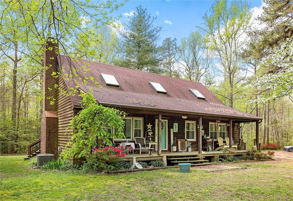 Adorable cottage with detached garage and covered patio!  This home is surrounded by trees for amazi