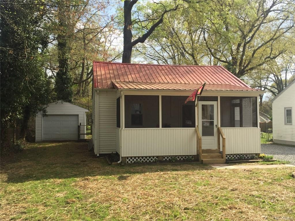 WOW ... This adorable bungalow/cottage styled rancher is located in the town of Ashland and features