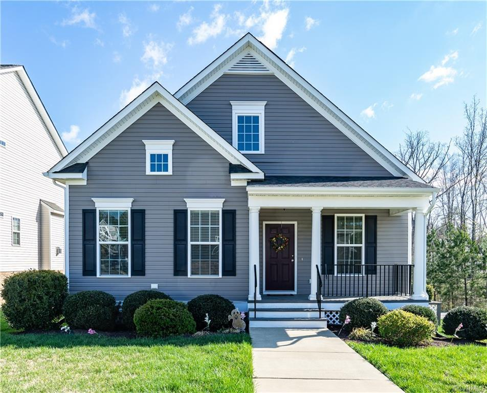 Welcome to 14724 Bridge Creek Dr.  This Energy-Star certified home has a $52,000 SOLAR Panel system installed in 2020 making the utility bills very low for the next 25+ years.  First floor primary & finished basement! No More Yard Work; HOA takes care of cutting grass! This home has an open concept, a sunny great room with beautiful hardwood flooring; spacious kitchen with granite countertops, center island w/bar seating, gas cooktop, wall oven & soft close drawers. Flex room off front porch can be used as a sitting, dining room, or office. Master suite on the main level, with walk-in closet and En Suite Bathroom with dual-sink vanity & walk-in shower with seat. Two spacious bedrooms on the second floor share a full bath. Finished basement with Rec room and 3rd full bath.   Large basement storage room holds everything, and unfinished walk-out workshop area can easily be finished for a fourth bedroom.  Upgraded HVAC, plus 220 v connections. The corner location offers unique privacy and wooded views from the deck and patio below. Conveniently located just off Midlothian Turnpike & 288, easy commute and quick access to hospitals, dining, retail & entertainment.  Great School System!