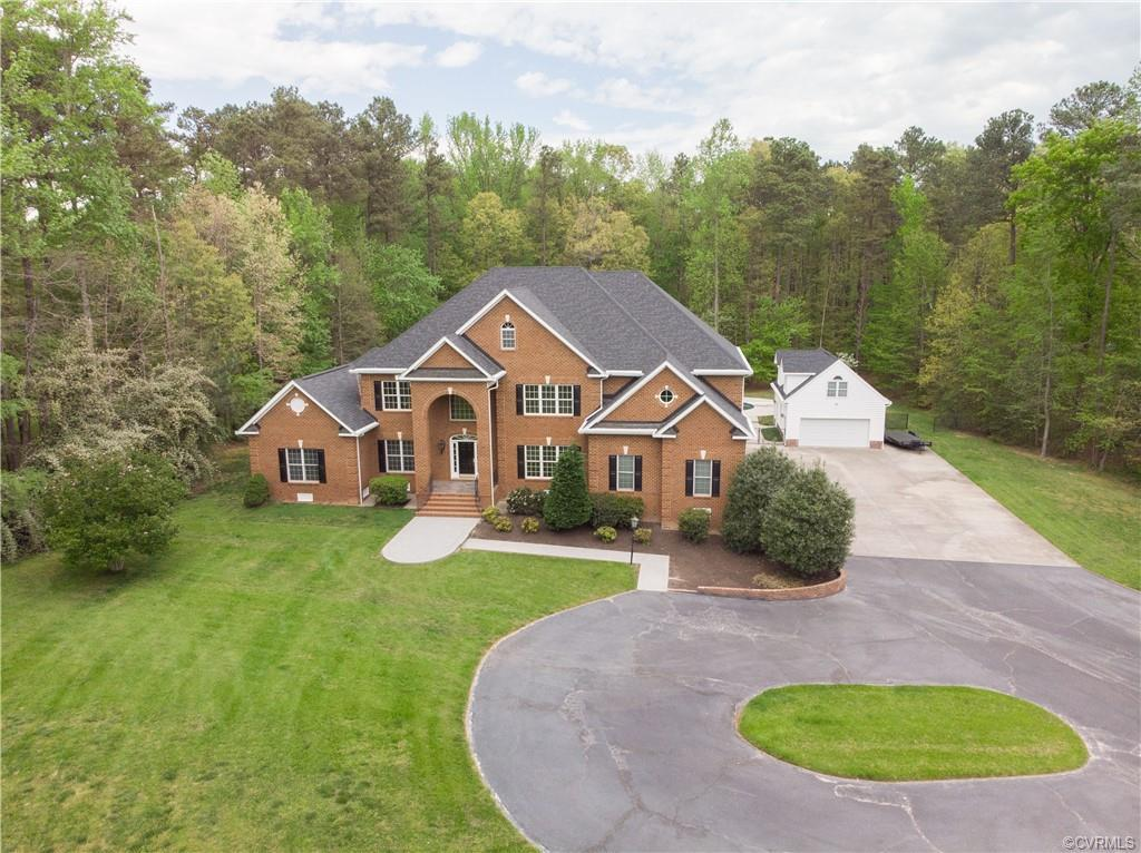 Welcome home to 12790 Kain Rd! Situated on an expansive, 4.5 acre lot, this exquisite home offers a