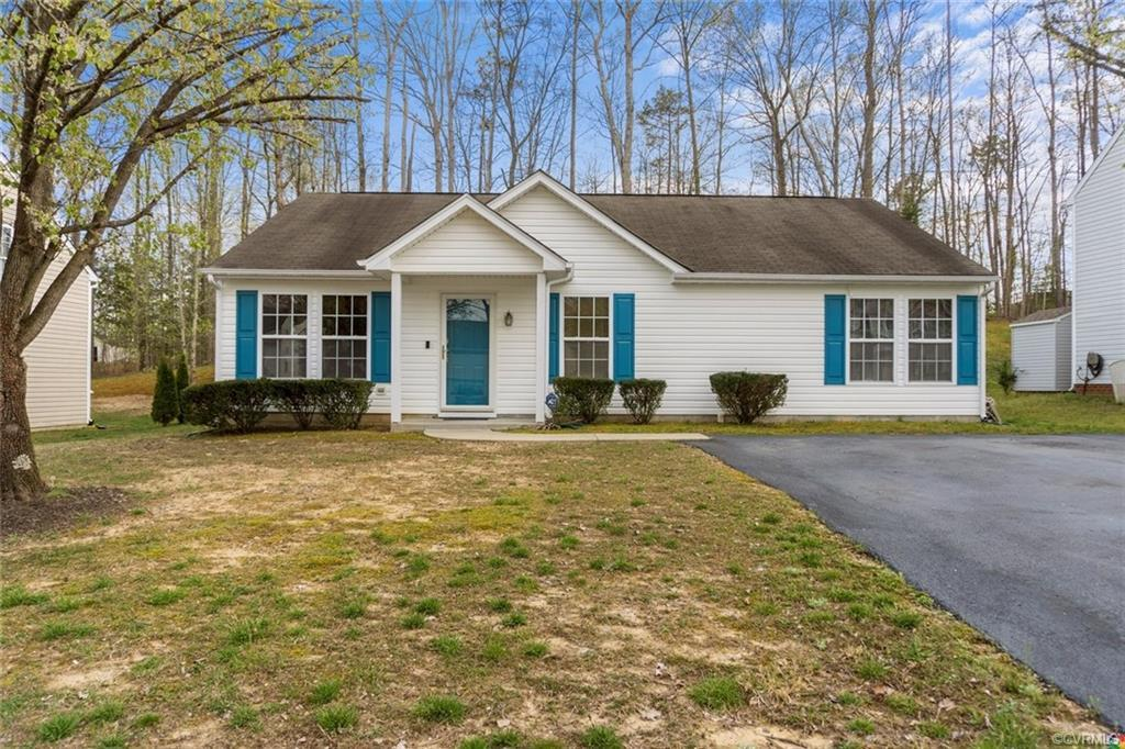 Welcome to the friendly subdivision of Ashbrook! 15113 Winding Ash Drive sits on a nice sized lot, w