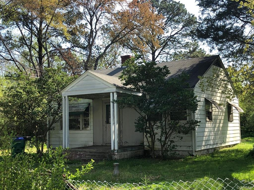 PRICED BELOW current assessed value. Cape cod on large lot centrally located in Forest Hill. Walking