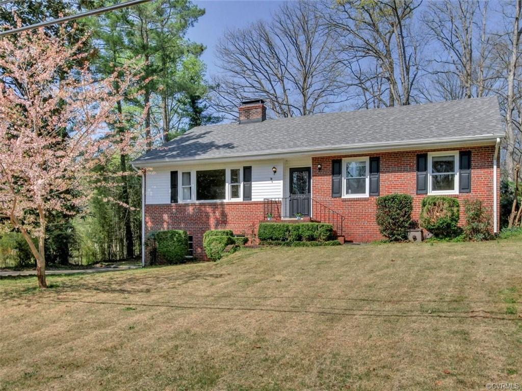 This charming brick ranch, situated on a private lot in a cul-de-sac, with a full walk-out basement