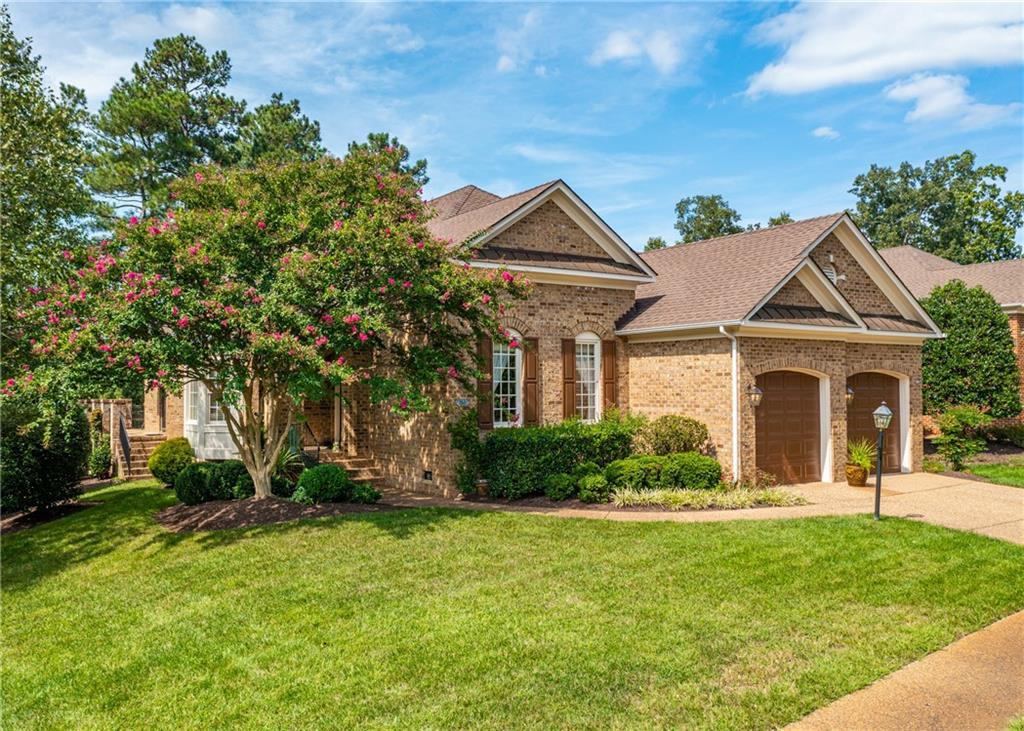 This all brick, beautiful, one owner home is located on the 6th fairway of  Independence Golf Course
