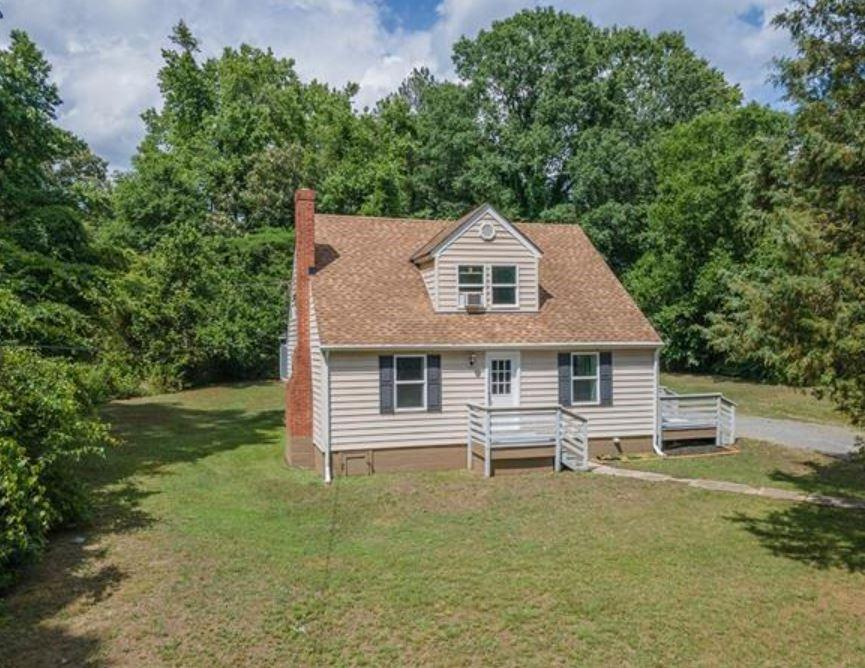 Don't miss this charming Cape located on a nearly half acre lot with easy access to Downtown Richmon