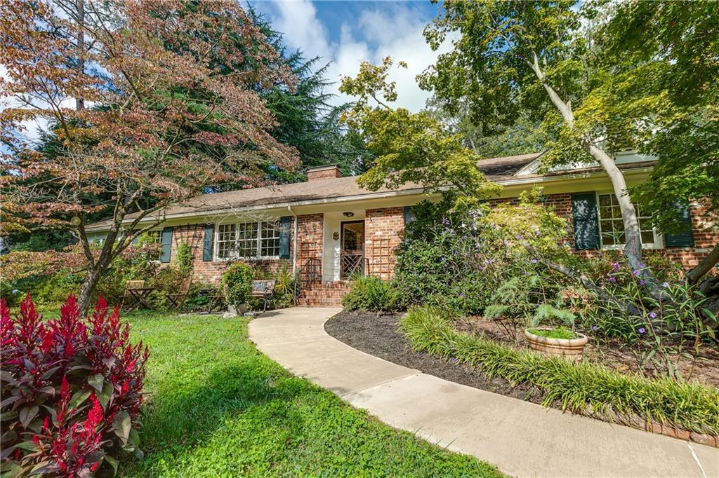 A mid-century home w/ a stunning, private, easy-to-maintain yard you will fall in love with! Step up