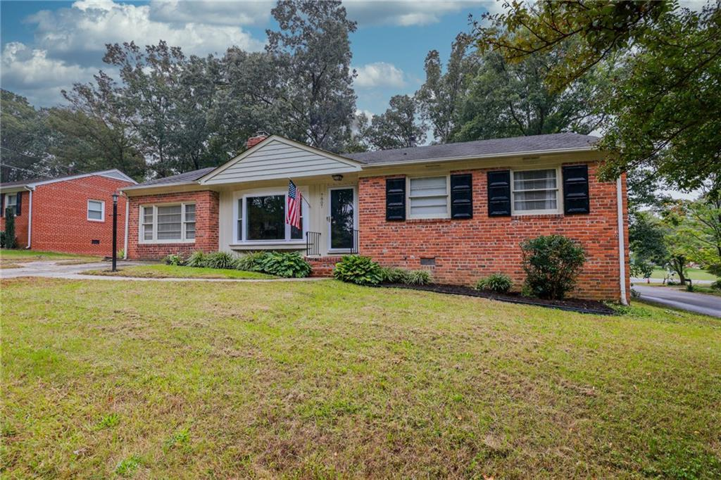 LOCATION, LOCATION, LOCATION!! This gorgeous brick rancher is nestled in the neighborhood of Tuckaho