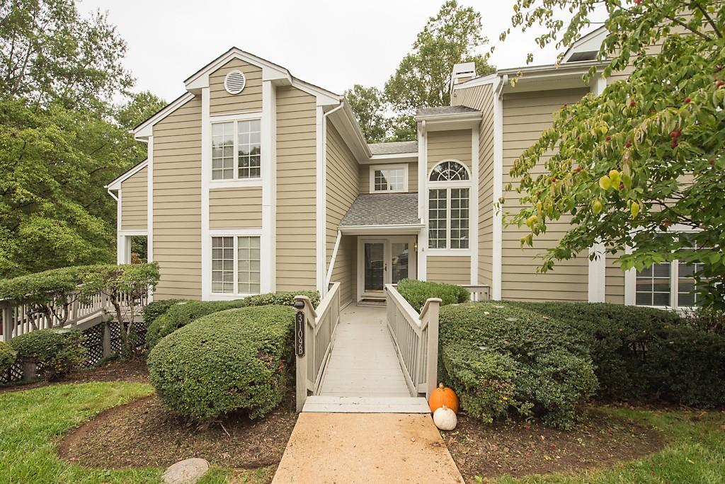 Gorgeous Bluffs Condo w/GARAGE included! Street level with very few steps into this open & bright pl