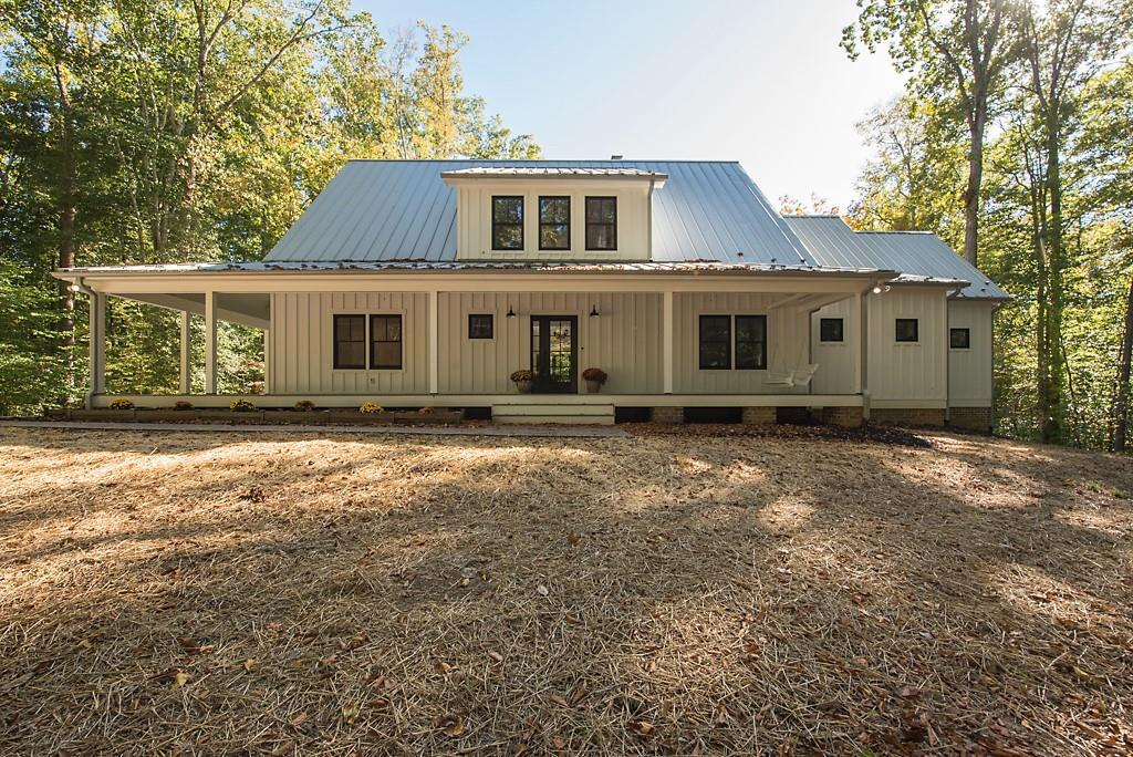 Welcome to this 2019 custom built  Modern Farmhouse resting on a 12 ac lot fronting on MeChumps Cree