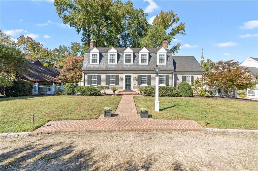 Welcome to 202 Oxford Circle East In the heart of Windsor Farms, this brick, slate, and frame Willia