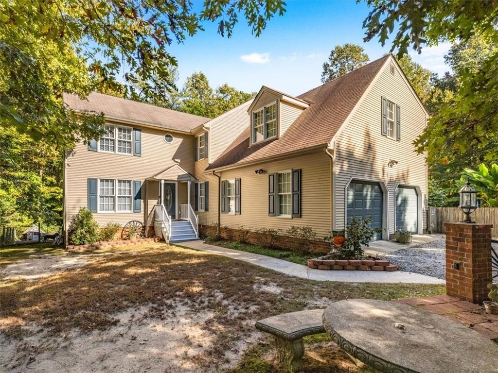 Charming 2-story home on a 2.8 acre private wooded lot offering a well layed out 3,084 sq ft, 6 bedr