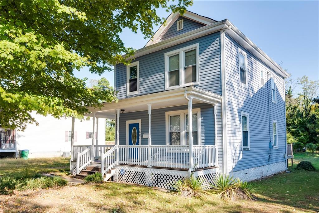 This updated 1920s Colonial with a wraparound porch is an absolute must see! On the first floor you'