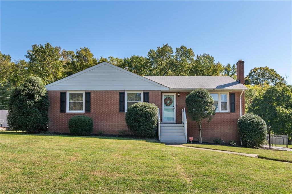 A lovely Brick Rancher with a full basement & two car detached Garage centrally located to Richmond