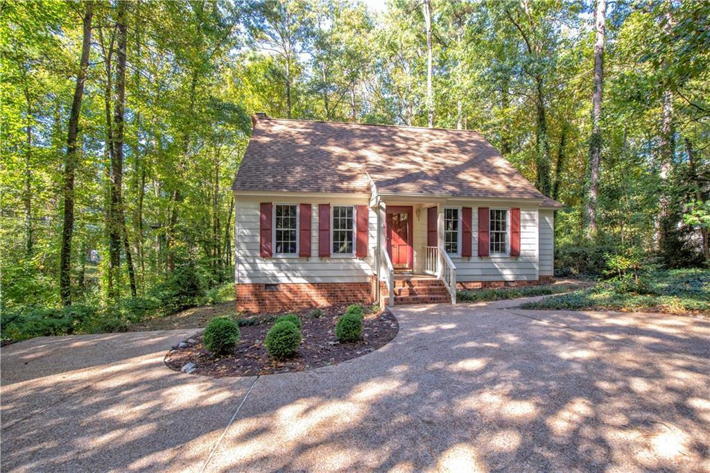 This charming Williamsburg Cape is privately situated on a beautiful, wooded lot just under one acre