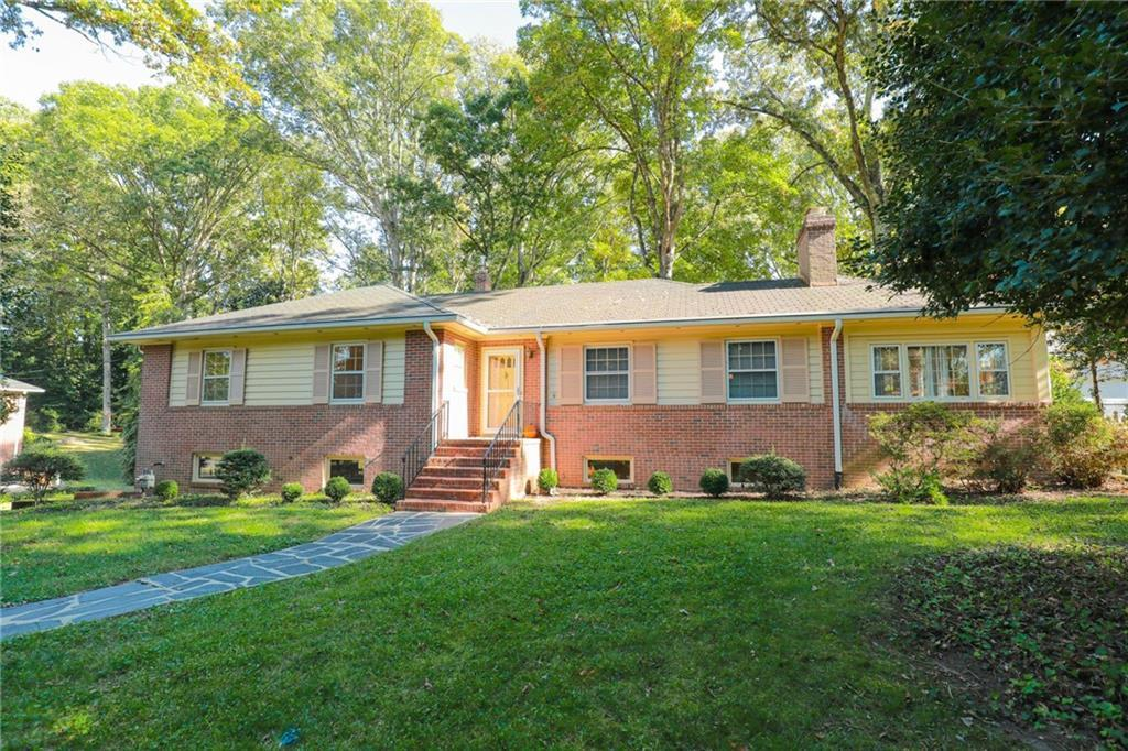 Classic Mid Century Brick & Slate Ranch with full finished basement & huge double garage & workshop
