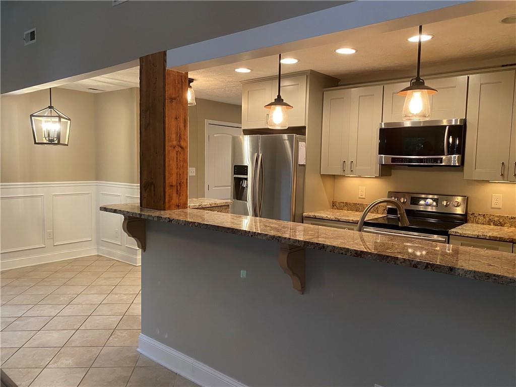 Modern haven awaits! Gorgeously designed 2 bedroom home in desirable school district!  Amazing and m