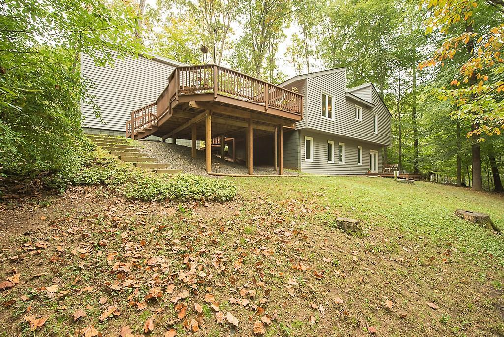 Nature and Privacy abound on this acre lot that gives a sense of being in the country, but is only 2
