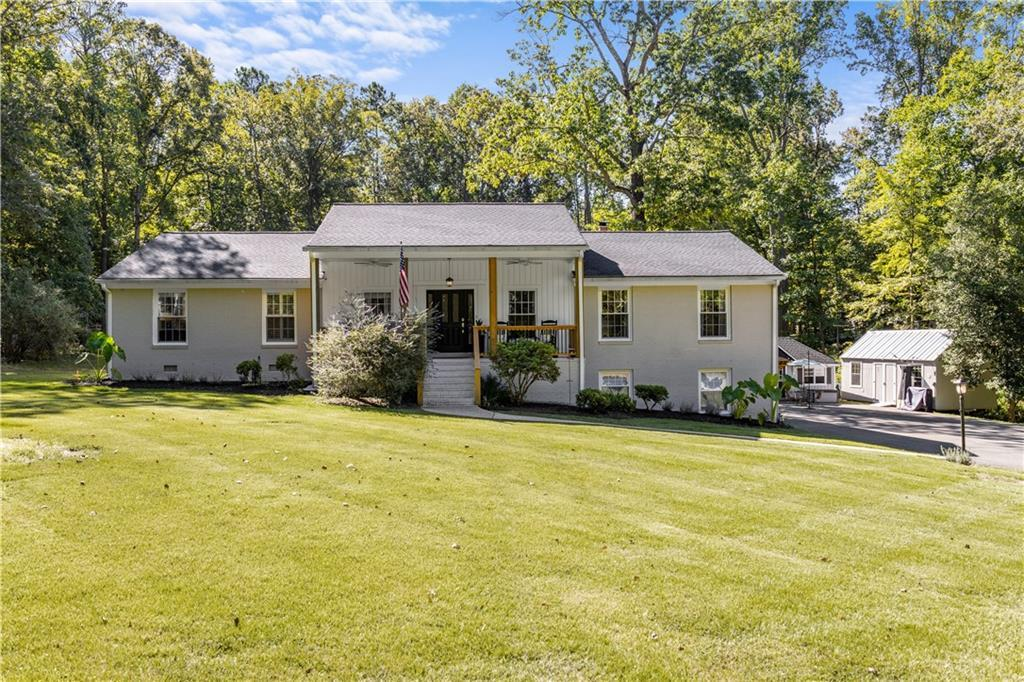 Stunning updated Brick Rancher on 1.76 acres with walk-out finished Basement. Kitchen has been updat