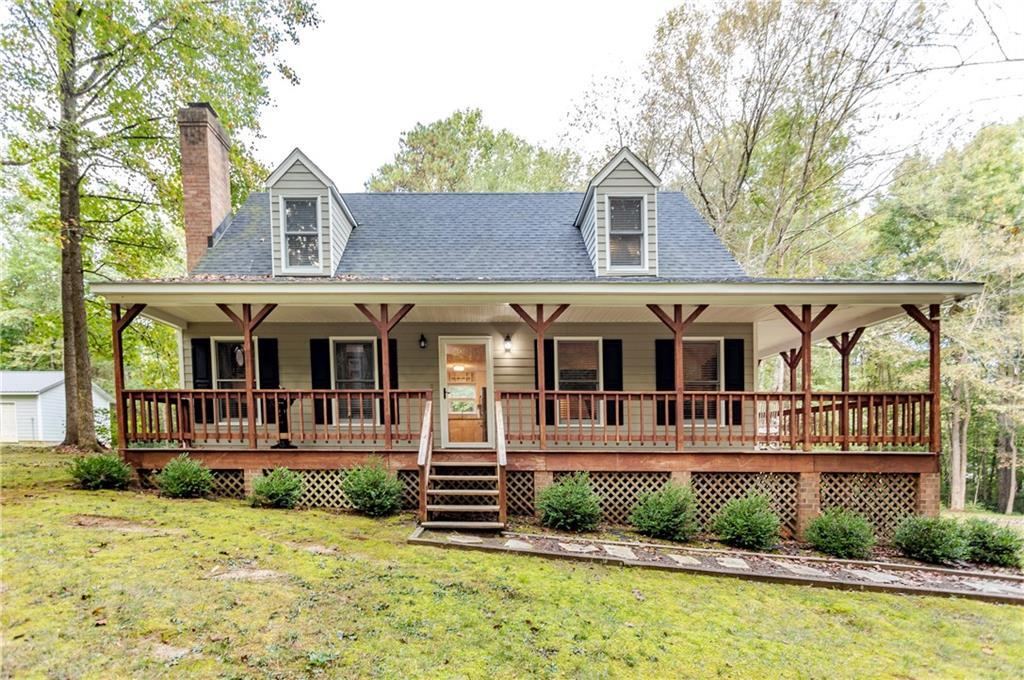 This one won't last long!!!!! Great cape cod on 2 acres in super convenient location. Private 2 acre