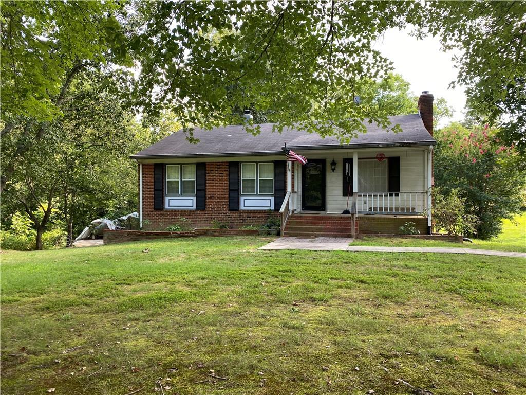 """Great home with TONS of potential! Needs TLC, but this well built, brick home sits on almost 1.5 acres. The main floor offers 3 nice sized bedrooms, bright family room and kitchen, and a spacious sunroom over looking the gorgeous private rear yard, (under the carpet on the main floor, it is believed that there are hard wood floors but not 100% positive). Down the stairs you will find an expansive rec room area with wood stove and plenty of natural light. The full size basement also includes a full bath with walk in shower, the 4th bedroom, laundry area, and private office area. The detached garage is oversized and with some TLC would be a great work shop or he/she shed! Located less than 10 minutes to Rt. 288, this property offers convenience and endless opportunities to its new owner! Property is being sold in """"AS IS"""" condition"""