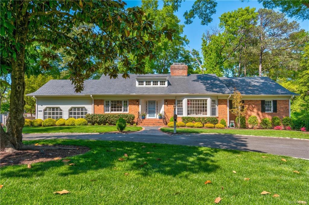 Gorgeous brick and slate home located in the desirable River Road Corridor. The formal dining and li