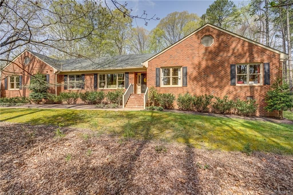 Lovingly maintained brick home nestled on a gorgeous wooded lot along the 3rd and 4th holes of the M