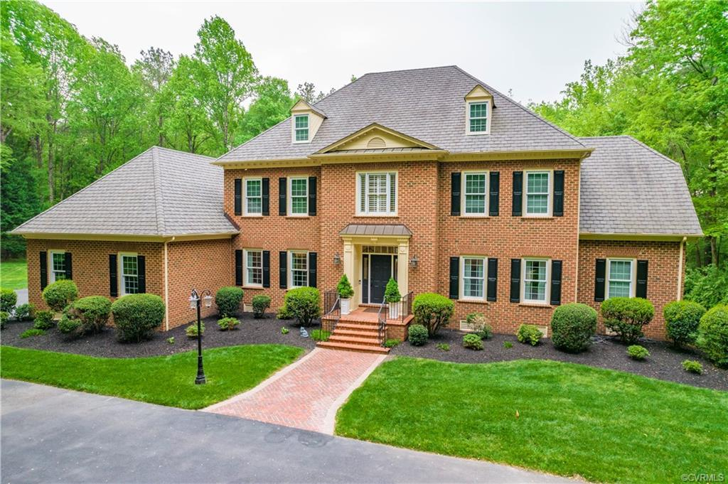 Welcome to this stately Georgian style home custom built  by Allen Coleman resting on a private 3.25