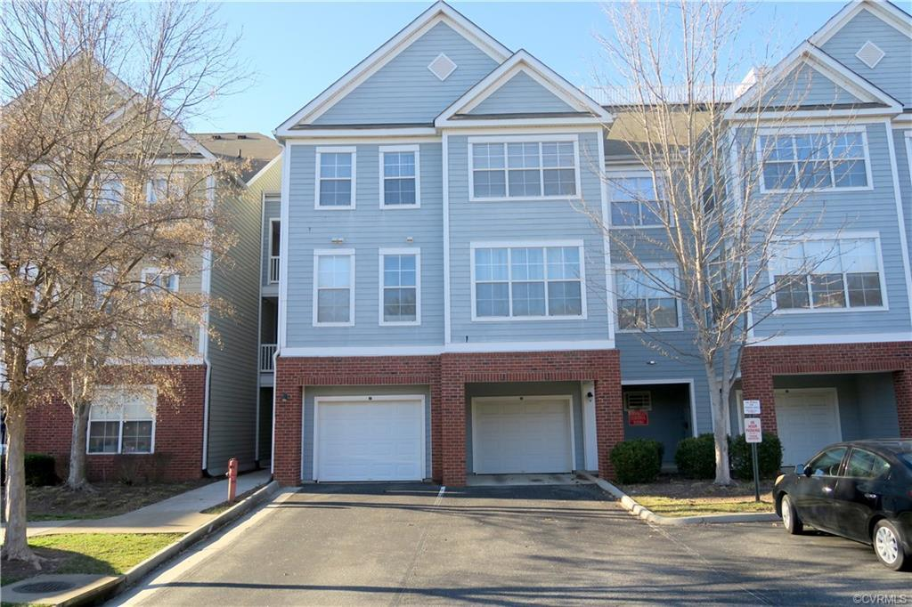 BRIGHT AND OPEN TOP LEVEL REAR UNIT WITH PRIVATE WOODED VIEW ~ 15 X 16 GREAT ROOM OFFERS VAULTED CEI