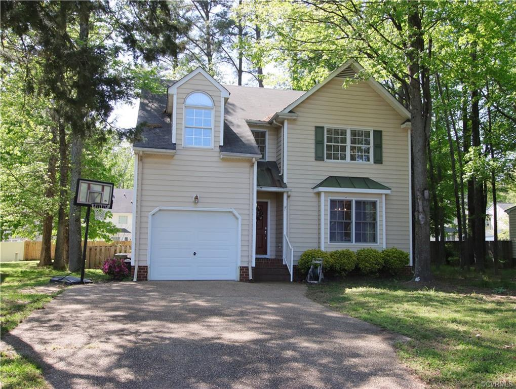 Vinyl sided home with four bedrooms and two and 1/2 baths with a one car attached garage. Home sold