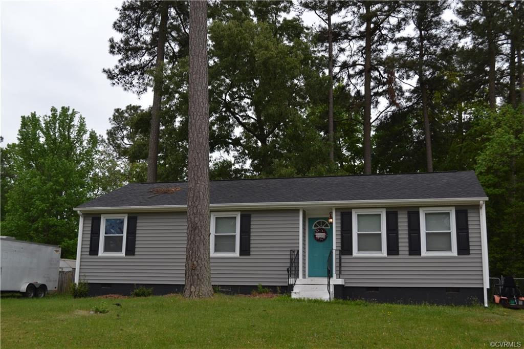 New Roof!  New Vinyl Siding! New Carpet!!!  Welcome home to this 3 bedroom 1 1/2 bath home all on on